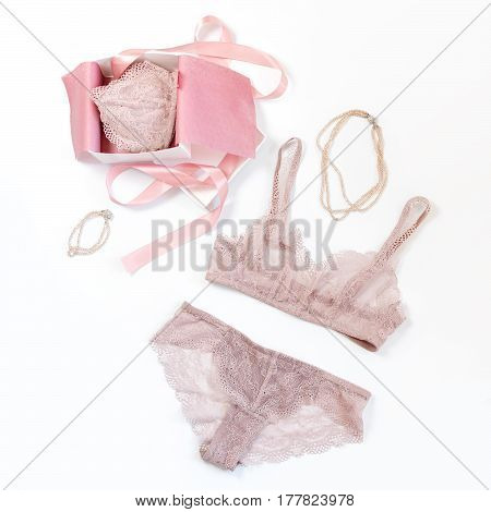 Shopping and fashion concept. Set of glamorous stylish sexy lace lingerie in pink giftbox with woman accessories on white background