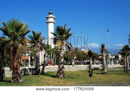 TORRE DEL MAR, SPAIN - OCTOBER 27, 2008 - View of the lighthouse and palm trees along the promenade Torre del Mar Malaga Province Andalusia Spain Western Europe, October 27, 2008.