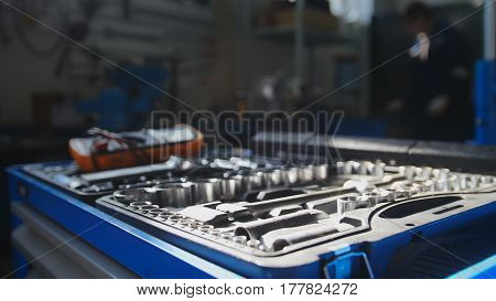 A set of tools for repair - screwdriver, voltmeter, wrenches - car repairing service, close up