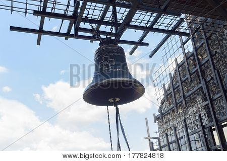 Bell on a background of a metal cage. The memorial complex to the victims of Holodomor in Ukraine in 1932-1933. Kiev
