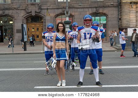 Kiev Ukraine - May 22 2016: Young players on the American football team conducted a campaign to popularize the sport in the street Khreshchatyk at the weekend