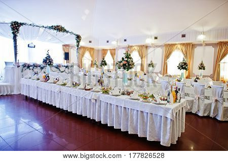 Elegant Wedding Reception Tables With Flowers And Decor.