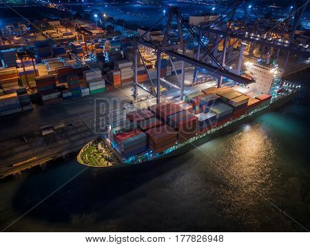 Vessel and container box in logistic port under loading by crane