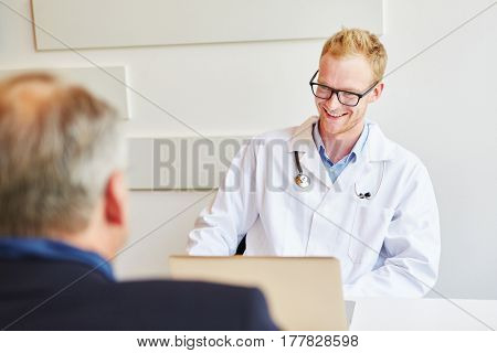 Doctor talking during consultation with patient