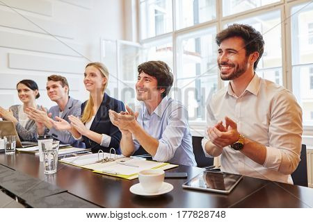 Business people applauding at successful meeting