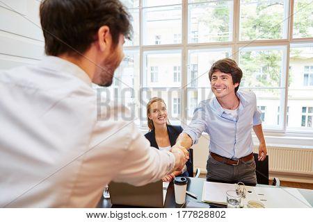 Business people shaking hands as a thank you gesture