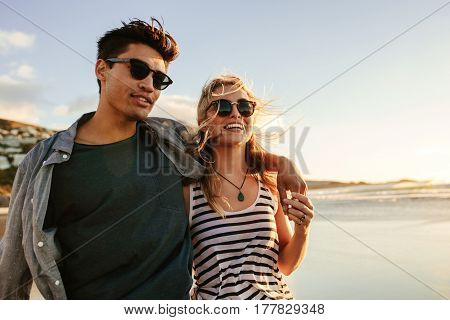 Young Couple Enjoying A Summer Day On Seashore