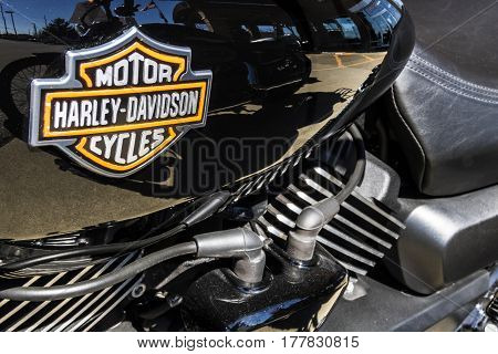 Indianapolis - Circa March 2017: Emblem and Engine of a Harley Davidson. Harley Davidson Motorcycles are Known for Their Loyal Following I