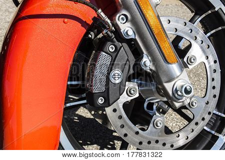 Indianapolis - Circa March 2017: Front Brake Caliper and Rotor of a Harley Davidson. Harley Davidson Motorcycles are Known for Their Loyal Following IV