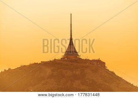 Jested mountain above the town of Liberec at sunset. Aerial photo