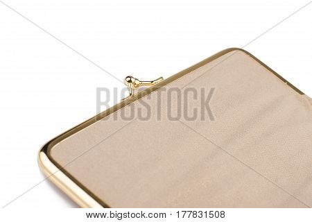 side view detail of closed vintage cream colored female handbag with golden metal enclosure isolated on white