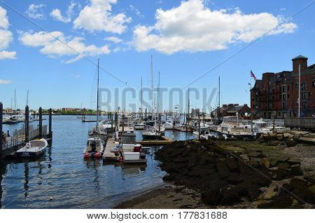 Boats docked and moored in Boston Harbor.