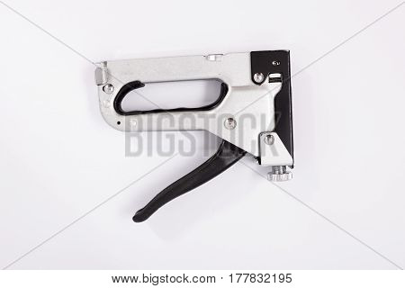 Gun For Staples On A White Background. Isolate
