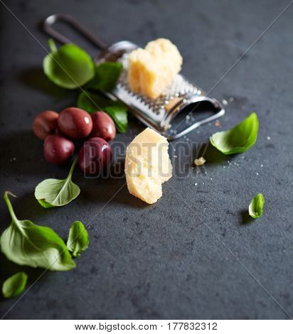 Still life with Parmesan, Olives and Basil (symbolic image)