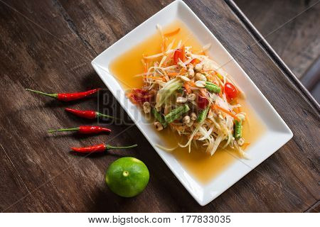Som tum Thai : Green papaya salad is a spicy salad made from shredded unripe papaya. This is very healthy food and famous in Southeast Asia region.