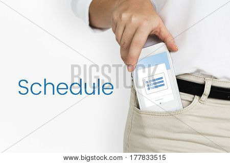 Hand holding digital device from trouser pocket network graphic overlay