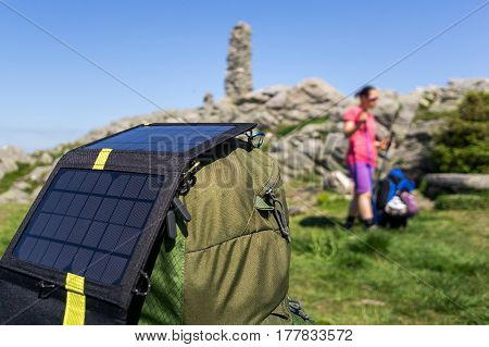 Solar charger in typical Scandinavian landscape in western Norway