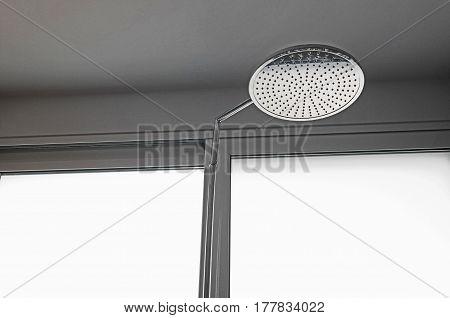 silver metal shower head in a villa's bathroom