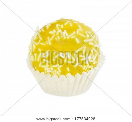 Cake Ball In Yellow Glaze With White Sprinkles In Paper Form