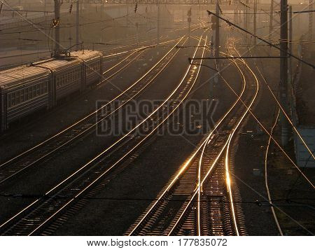 The railway in the rays of the setting sun