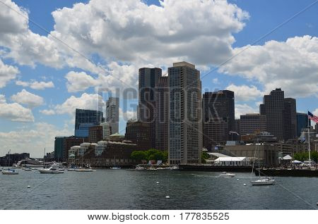 City of Boston skyscrapers and the harbor in the foreground.