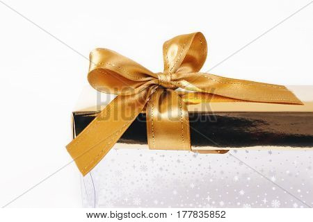 Christmas decor. Gold bow isolated on a white background