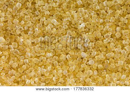Closeup macro of unrefined unbleached Crystalline sugar in crystal brown color