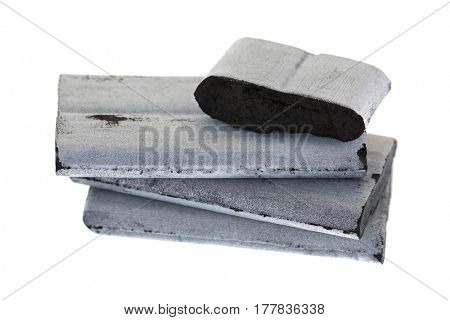 Closeup of square high temperature incense Bamboo silver charcoals to use with aromatic resin gum, free of chemical additives isolated on white background