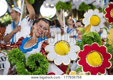 Lisbon Portugal - June 12 2014: Smiling woman at the parade of popular marches (Marchar Populares) along the Liberdade Avenue (Avenida da Liberdade) in Lisbon Portugal