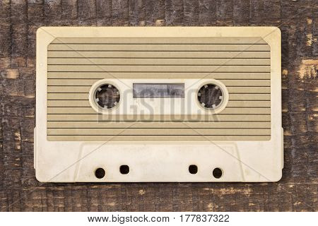 Vintage audio tape on brown wooden background