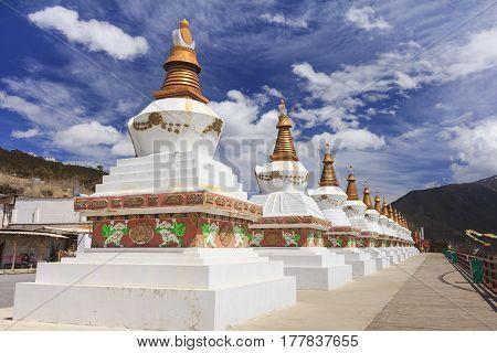 Row of stupas at the gate of Deqing city Yunnan China