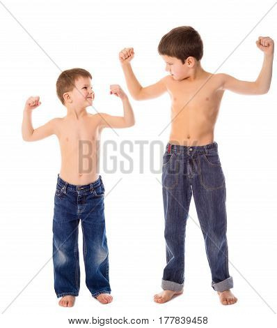 Two boys show each other his muscles, isolated on white