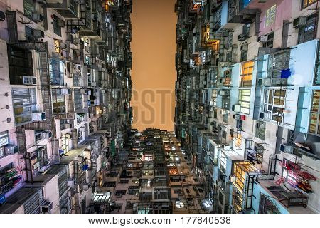 Low angle view of crowded residential towers in an old community in Quarry Bay Hong Kong. Scenery of overcrowded narrow apartments a phenomenon of high housing density & housing blues in Hongkong. poster