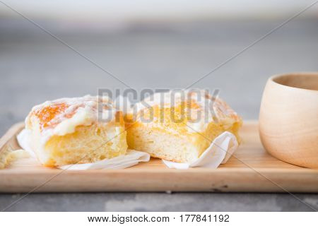 Fresh bread with icing and butter and hot tea or hot coffee