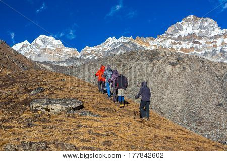View of Mountain Settlement in Nepal and group of Himalaya Climbers doing acclimatisation Training in for high Altitude Performance