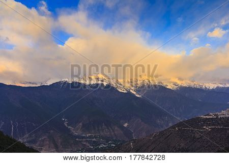 Sunrise scenery of Meili snow mountain and golden light at mountain peak this is viewpoint from Feilai temple Deqing Yunnan China