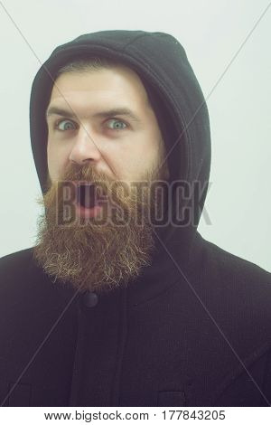 Bearded Happy Brutal Caucasian Man In Black Jacket And Hood