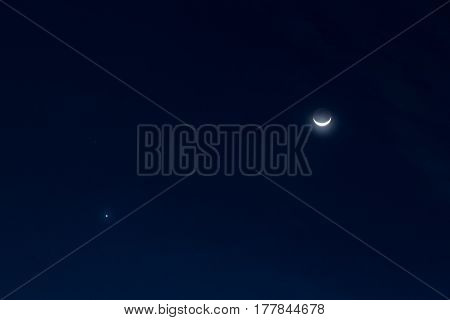 Half moon and star over the sky in the night