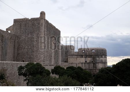 DUBROVNIK, CROATIA - DECEMBER 01: Defense walls of the old town of Dubrovnik, a well-preserved medieval fortress and a popular tourist destination, Croatia on December 01, 2015.
