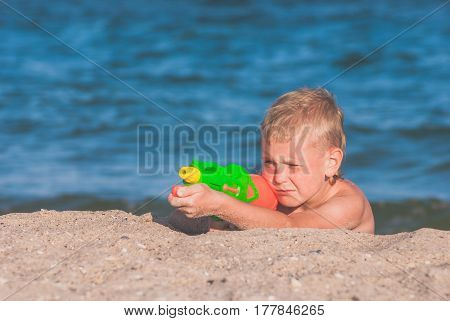 Little Boy Play With Water Gun 2