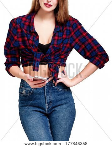 Fashion young woman using smartphone, wearing  checkered shirt and blue jeans, isolated on white background