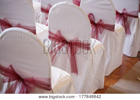 Bows made of fabric. accessory chair bow wedding registration.