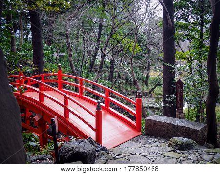 Tsutenkyo Red Bridge in Koishikawa Korakuen Garden Japan