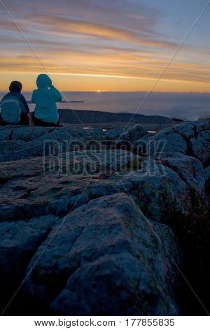 Silhouette Of Tourists Watching Sunrise At Cadillac Mountain In Acadia National Park