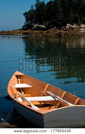 Small Peach Rowboat On Coast Of Maine