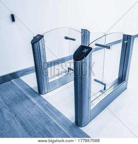 Entrance to office with stainless steel turnstiles.