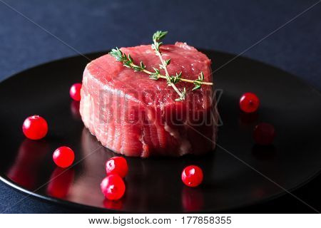 Raw Meat On Black Plate And Dark Background