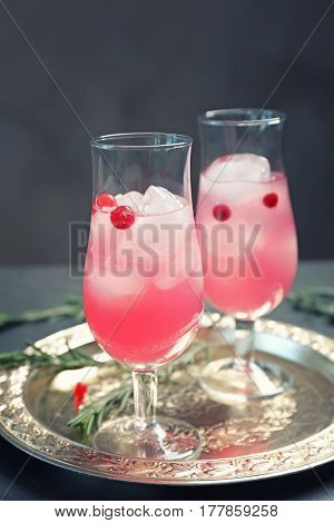 Glasses with delicious wine spritzer on silver tray