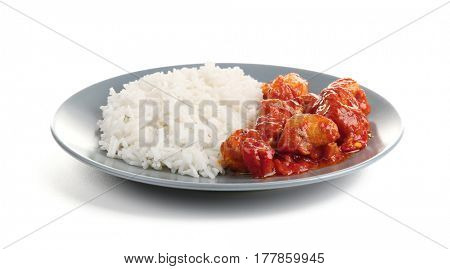 Plate with delicious chicken tikka masala and rice isolated on white