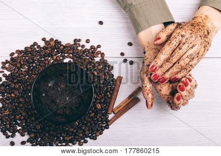 Closeup Of Female Hands And The Coffee Scrub